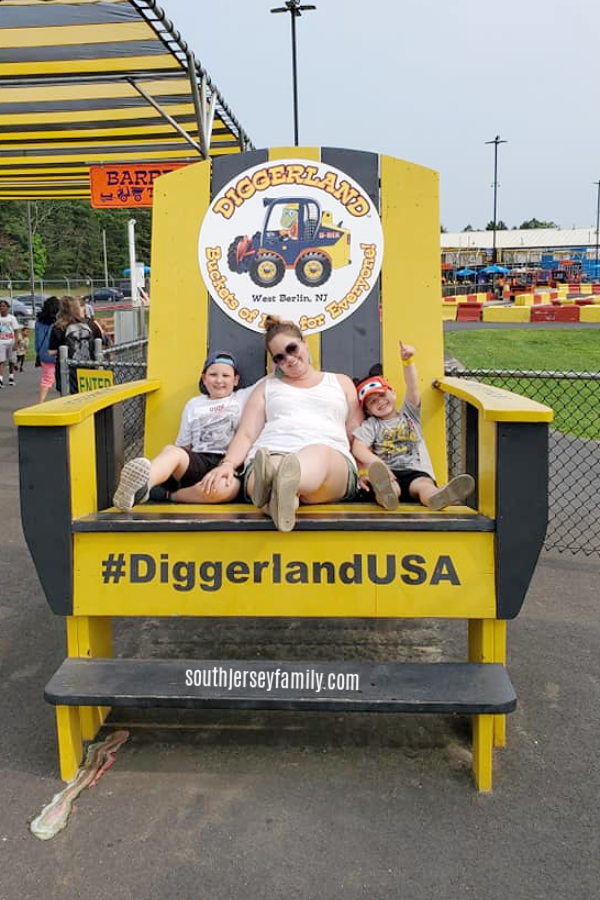 the boys and I sitting in a large chair at diggerland